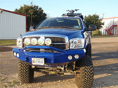 Front view of a blue ATV
